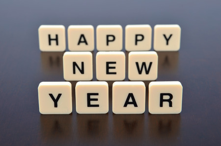 Happy New Year word formed by letter pieces photo