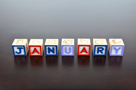 January word formed by wood alphabet blocks photo