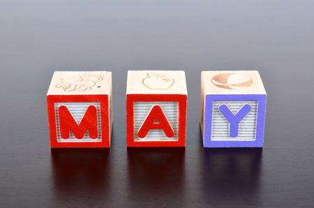 May word formed by wood alphabet blocks photo