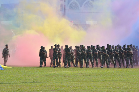 KUANTAN, MALAYSIA - AUG 31: Royal Malaysia Army demonstrate a combat defending at National Day parade, celebrating the 55th anniversary of independence on August 31, 2012 in Kuantan, Pahang, Malaysia.