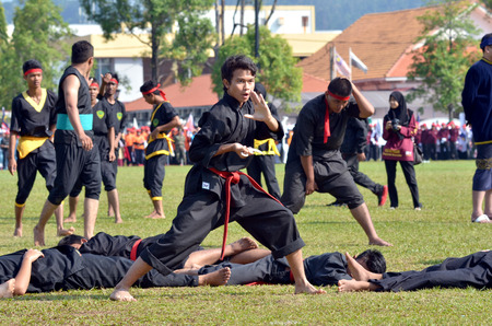 KUANTAN, MALAYSIA - AUG 31: Unidentified martial artist demonstrate a silat, malay tradisional discipline at the National Day parade, celebrating the 55th anniversary of independence on August 31, 2012 in Kuantan, Pahang, Malaysia.