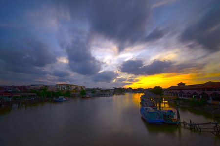 estuary: old town of Mersing with beautiful sunset over the river, Malaysia Stock Photo