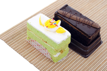 two tasty slice cakes on bamboo mat  photo