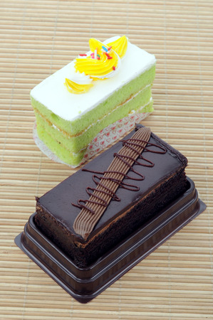 two tasty slices cake on bamboo mat photo