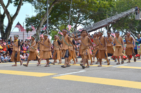 KUANTAN-AUG 31: Unidentified Malaysian kids participate in National Day parade, celebrating the 55th anniversary of independence on August 31, 2012 in Kuantan, Pahang, Malaysia.