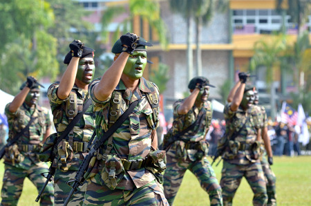 pahang: KUANTAN, MALAYSIA - AUG 31: Royal Malaysia Army demonstrate a hand combat defending at the National Day parade, celebrating the 55th anniversary of independence on August 31, 2012 in Kuantan, Pahang, Malaysia. Editorial