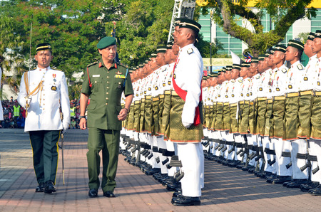 pahang: KUANTAN, MALAYSIA - AUG 31: Tengku Mahkota of Pahang state walking as he checked the honour during celebrating the 55th anniversary of independence day on August 31, 2012 in Kuantan, Pahang, Malaysia.