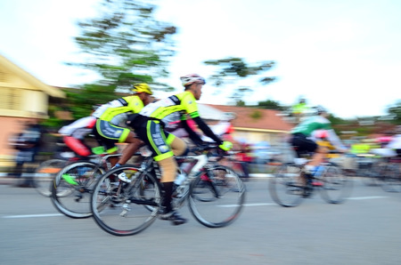 action blur: Motion blur of a group of cyclists in action during a cycling tour Stock Photo
