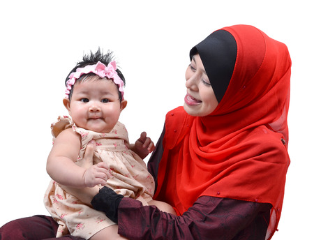 muslim baby girl: Young Asian muslim mother playing and smiling with her cute baby girl isolated on white background