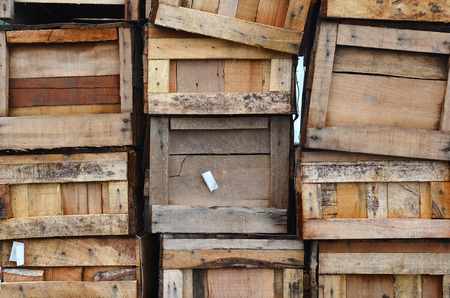 vertically: Old wooden boxes stacked vertically