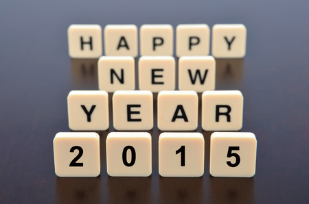 Happy New Year 2015 word formed by letter pieces, focus pointed at the front and shallow DOF photo