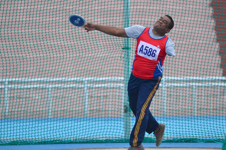discus: KUANTAN - DECEMBER 10: unidentified discus throw athlete (male) in action during training for Paralympic Games on December 10, 2012 in Kuantan, Pahang, Malaysia.