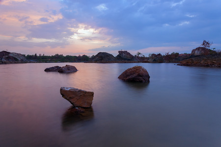 stepping stone: The stepping stone. This is a abandon quarry and the picture was captured during sunset with the stone in the middle of the picture.