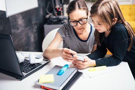 home office multitasking. brilliant office multitasking connection mother and daughter using smart phone at home  office stock photo inside home office multitasking
