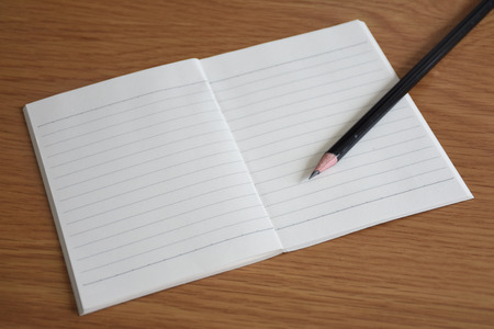 room for your text: A white note book with lots of room for your text or image and a regular pencil on a wooden desk