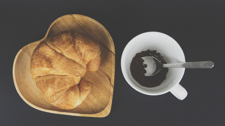 Croissant breakfast with coffee.