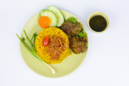 yellow rice with beef and sauce on white background Stock Photo