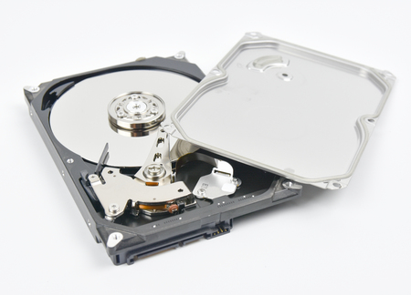 data archiving: Hard disk open  on white background.