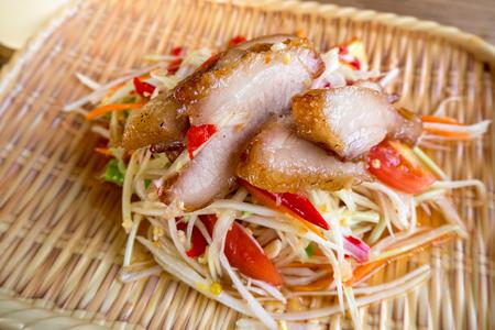 Local Thai food, Som tum, papaya salad served in a modern restaurant Stock Photo