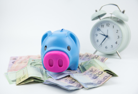 Piggy bank on soft WHITE background with THAI BATH money banknotes. Stock Photo