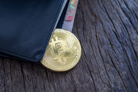 Bitcoin and money in a wallet