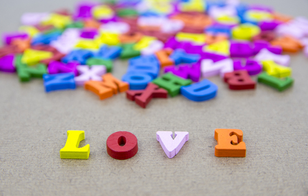 Word of LOVE on the background with colorful alphabet
