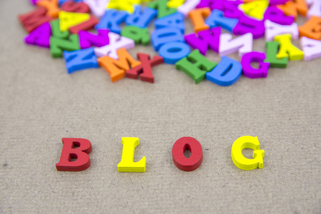 Word of BLOG on the background with colorful alphabet
