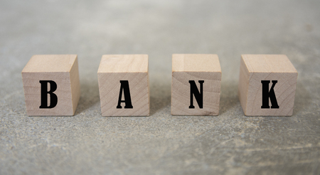 concept word forming with cube on wooden desk background - BANK Фото со стока