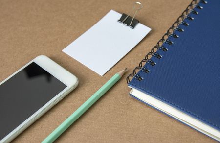 Notepad with pencil on wood board background. using wallpaper or background for education
