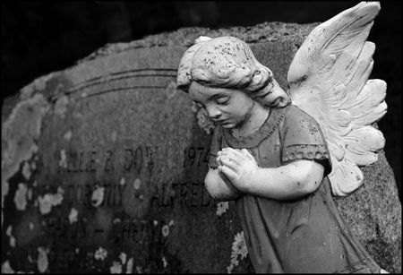 obituary: an stone angel grave marker