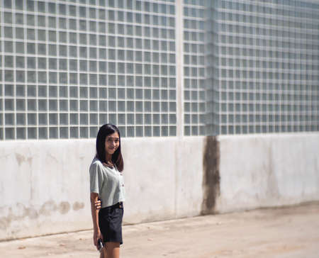 Blue shirt woman with glass wall