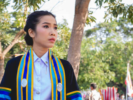 The graduate wore a gown from a university in Thailand. For graduation in 2020