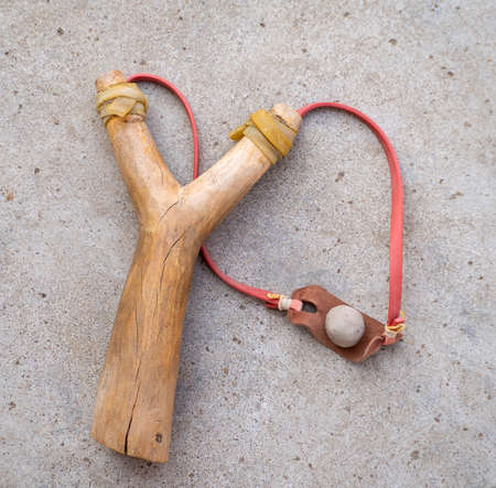 A catapult made of wood and a ball of clay.