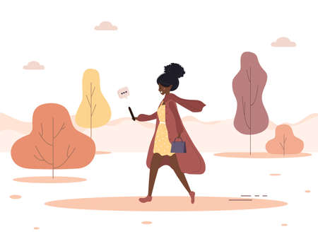 Autumn background. Young african woman walks in park and talks over video call. Blogger takes a selfie and holds smartphone in his hand. Vector illustration in flat style.