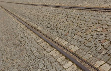 tramline: Cobbled street with tram rails in summer Stock Photo