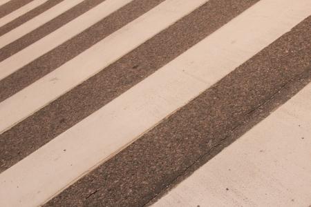 Closeup of Zebra crossing in summer, diagonal view photo