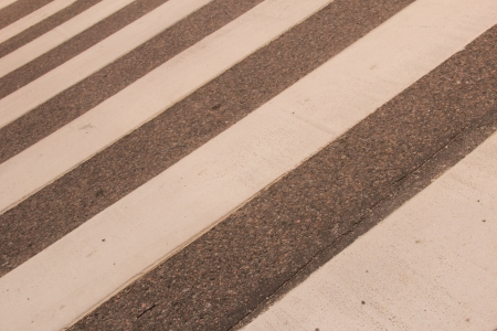 Closeup of Zebra crossing in summer, diagonal view photo