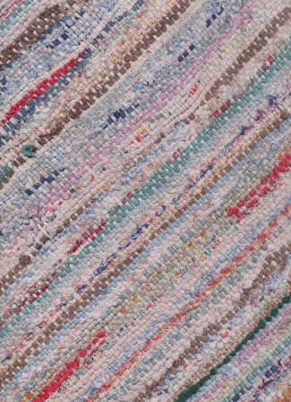 wornout: Diagonally closeup of old worn-out striped rag rug
