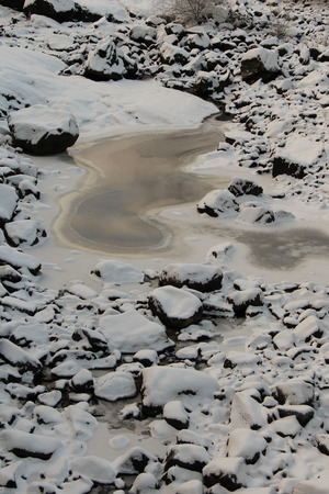riverbed: Frozen riverbed with snowy rocks in winter