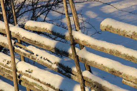 swedish: Old Swedish wooden fence in winter