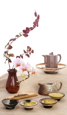 Still life with green tea and flowers.   photo