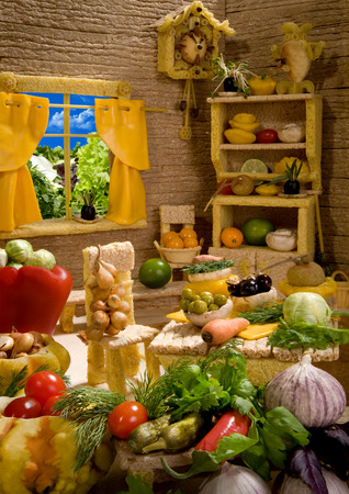 Kitchen interior made from breadsticks, macaroni, snacks and others different foods. Handiwork.