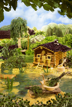 macaroni: Landscape with bathhouse made from breadsticks, macaroni, snacks and others different foods. Handiwork. The image is made from multiple files.