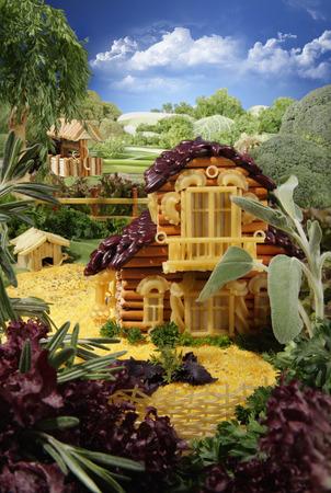 handiwork: Paisaje con casa hecha de palitos de pan, macarrones, bocadillos y otros alimentos diferentes. Obra. La imagen est� hecha de m�ltiples archivos. Foto de archivo