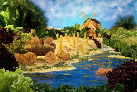 macaroni: Landscape with windmill made from breadsticks, macaroni, snacks and others different foods. Handiwork. The image is made from multiple files.