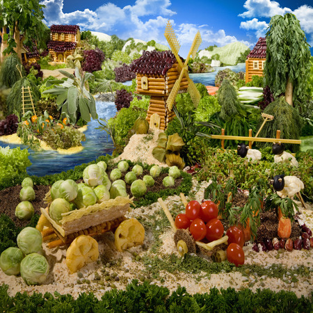 gather: Village made from breadsticks, macaroni, snacks and others different foods. Handiwork. The image is made from multiple files. Stock Photo