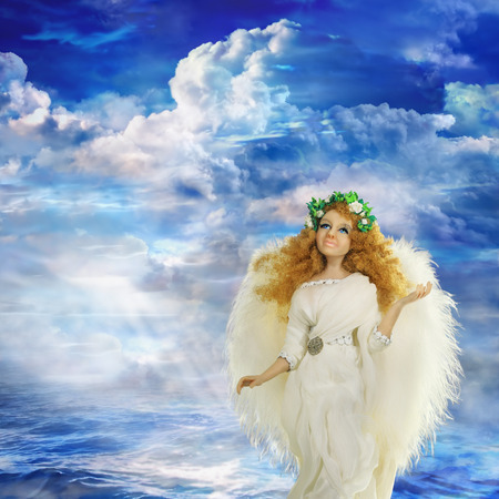 Angel as a herald of mercy and forgiveness. A wreath of white roses as a symbol of divine harmony of the universe, infinity of the world and human life. The image is made from multiple files.