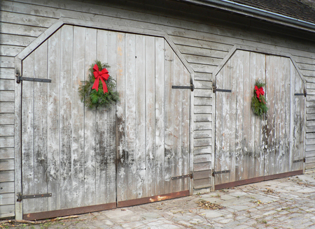 Christmas swags on rustic barn board doors