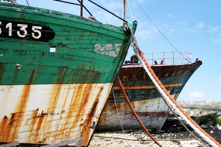Abandoned ship rusty ship worn old at low tide