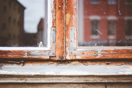 coatings: Old window frames with loose paint